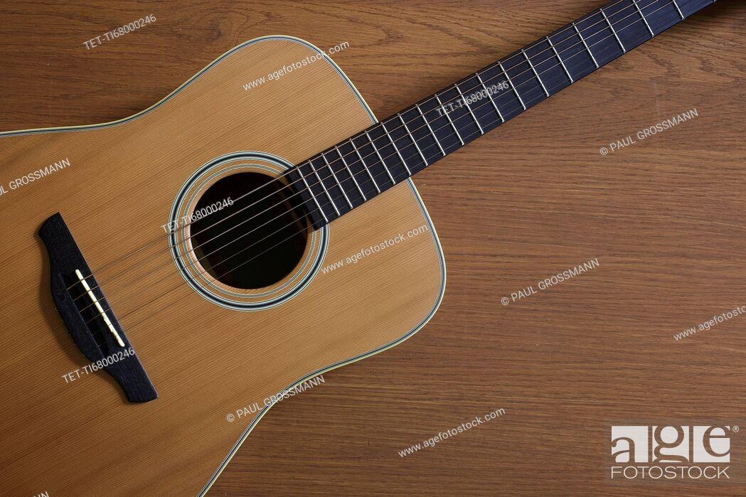 Stock Photo: Acoustic guitar lying on floor.