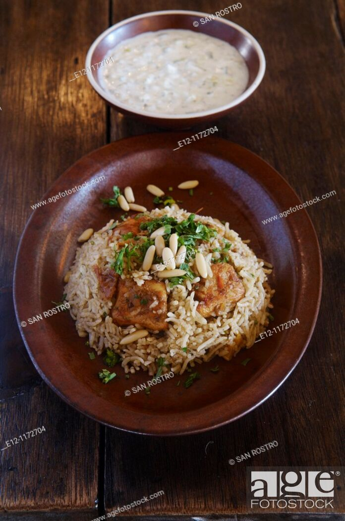 Stock Photo: Middle East, Oman, traditional Omani dishes, chicken maqbous or majbous, kind of byriani  always served and mixed in the plate with cucumber yaourt.
