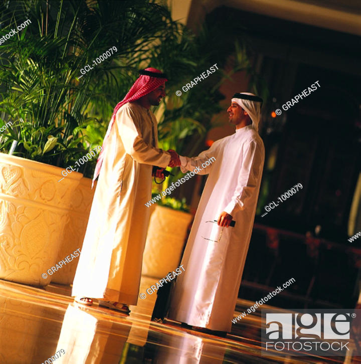 Stock Photo: Arab businessmen shaking hands.