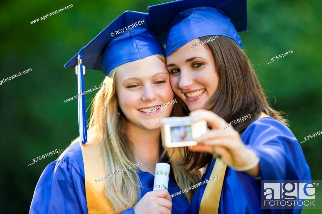 Stock Photo: Graduates pose for photo.