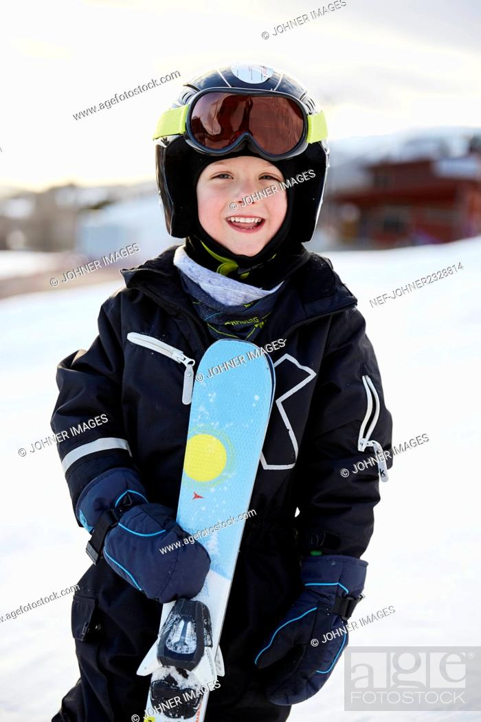 Photo de stock: Smiling boy with skis.