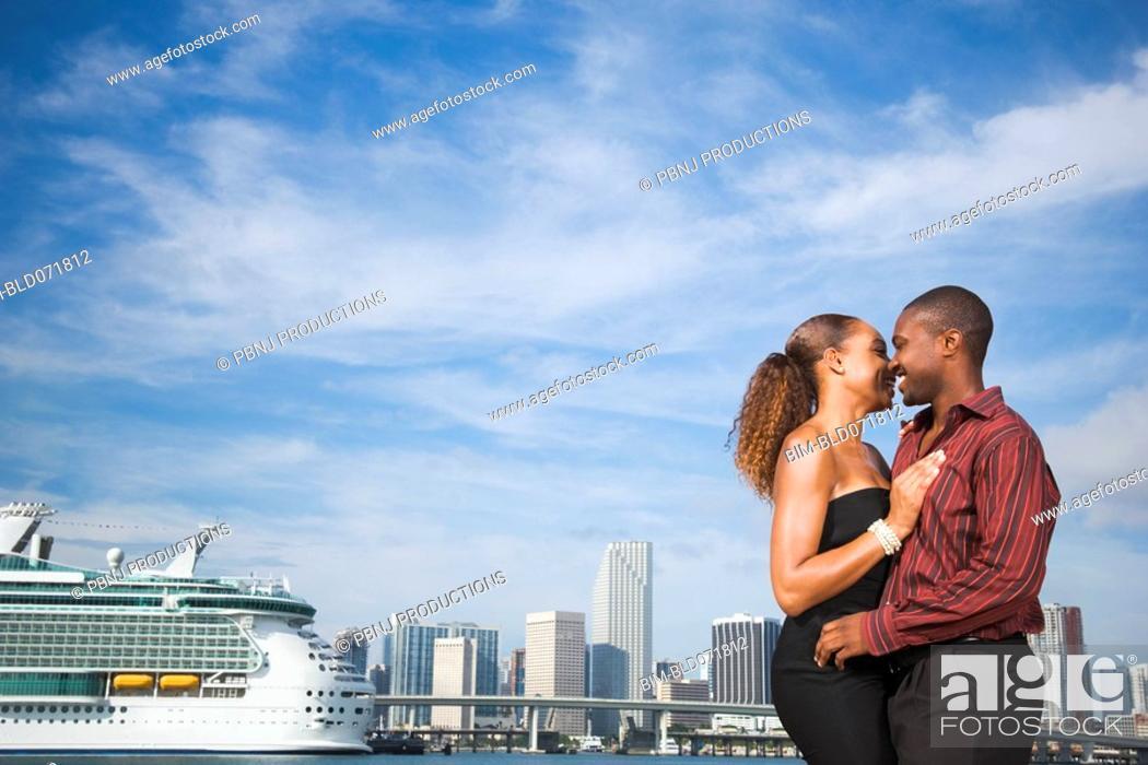 Stock Photo: African American couple hugging.
