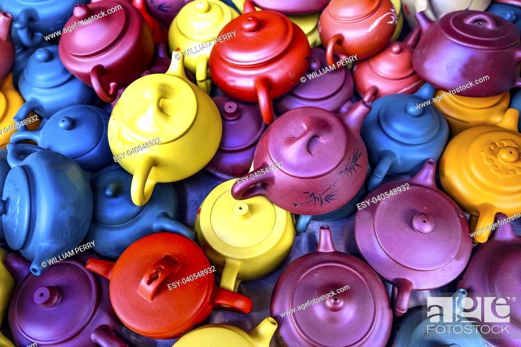Stock Photo: Old Chinese Ceramic Tea Pots Panjuan Flea Market Beijing China. Panjuan Flea Curio market has many fakes, replicas and copies of older Chinese products.
