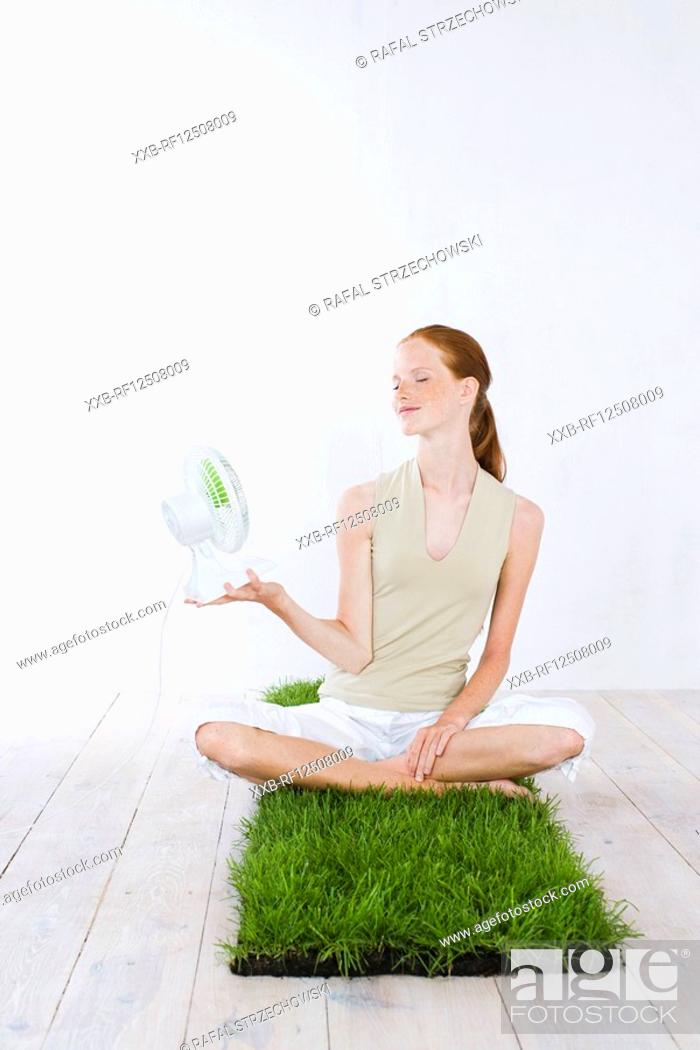 Stock Photo: young woman holding fan.