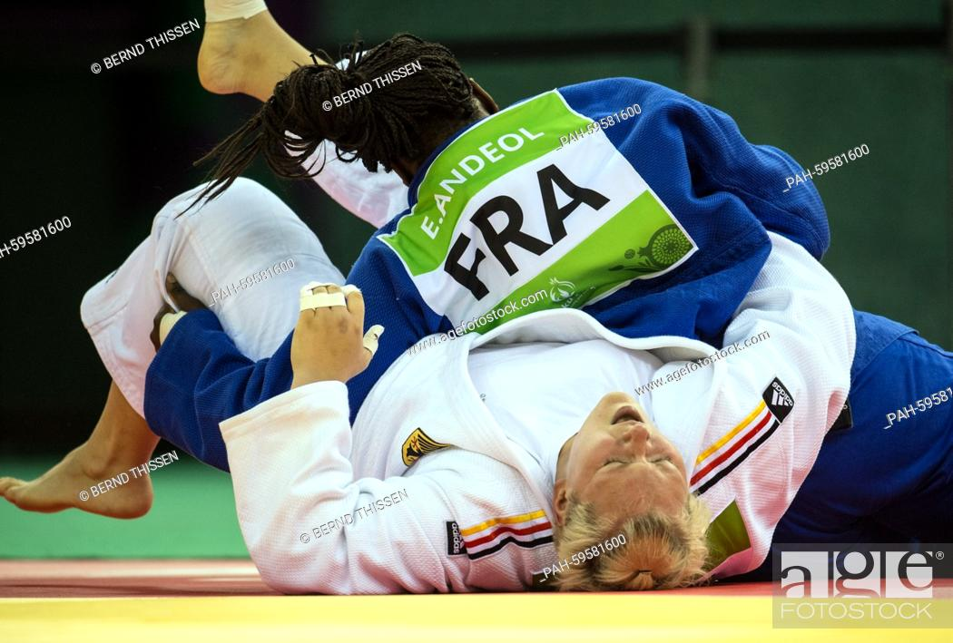 Stock Photo: Germany's Jasmin Kuelbs (white) competes in the Women's +78kg Final with Emilie Andeol of France at the Baku 2015 European Games in Heydar Aliyev Arena in Baku.