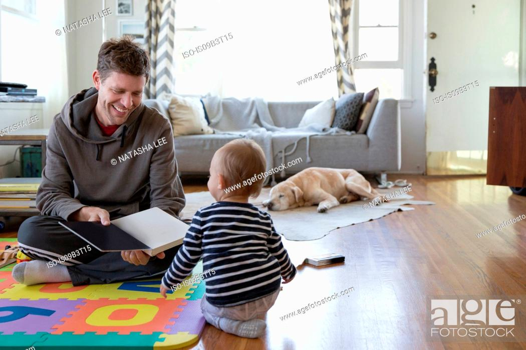 Stock Photo: Father and young son at home, playing.