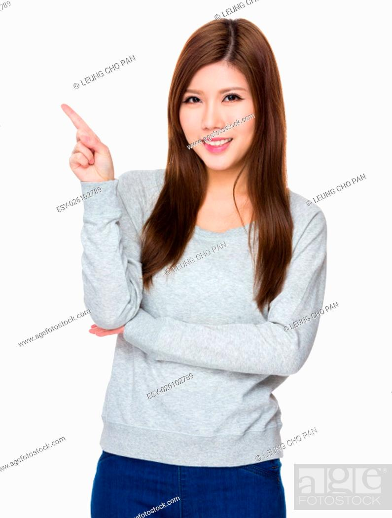 Stock Photo: Asian Young Woman showing finger point up.