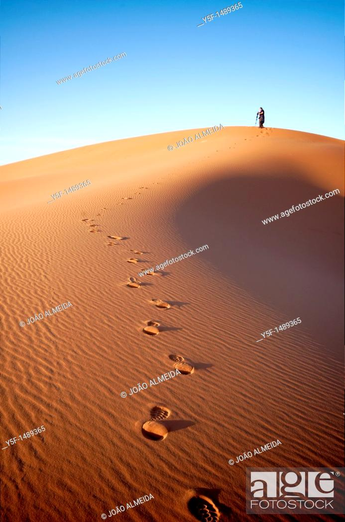 Stock Photo: People at the dunes of the Moroccan Sahara.