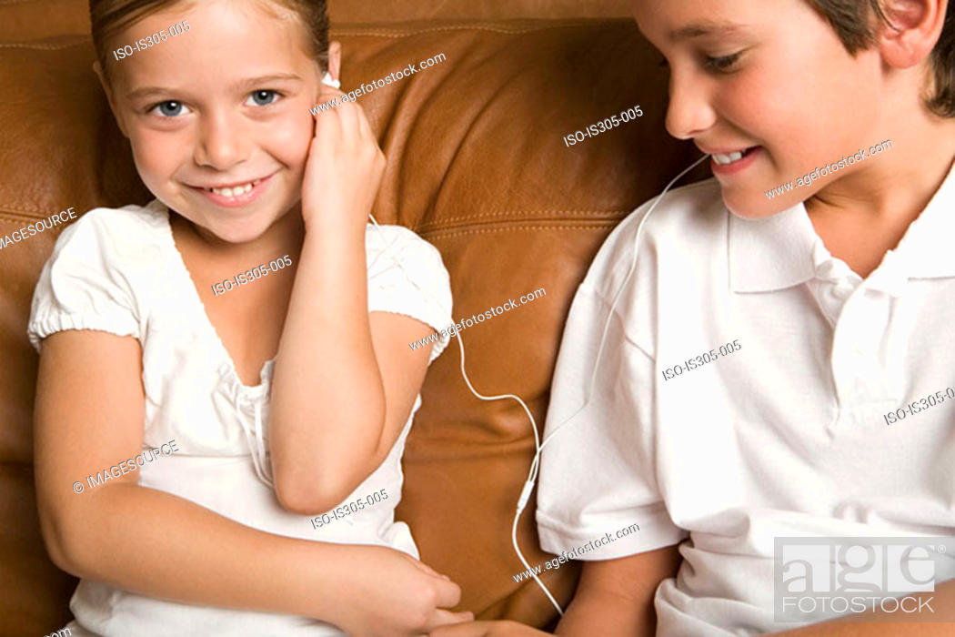 Stock Photo: Brother and sister listening to music.