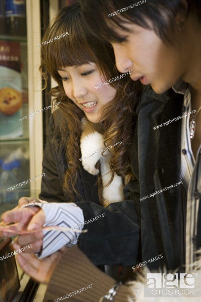 Stock Photo: Couple reading menu.