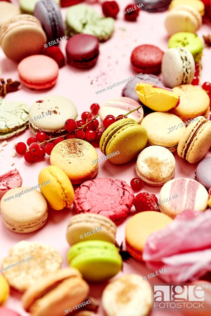 Stock Photo: Still life of different varieties of French macarons on a pink background.