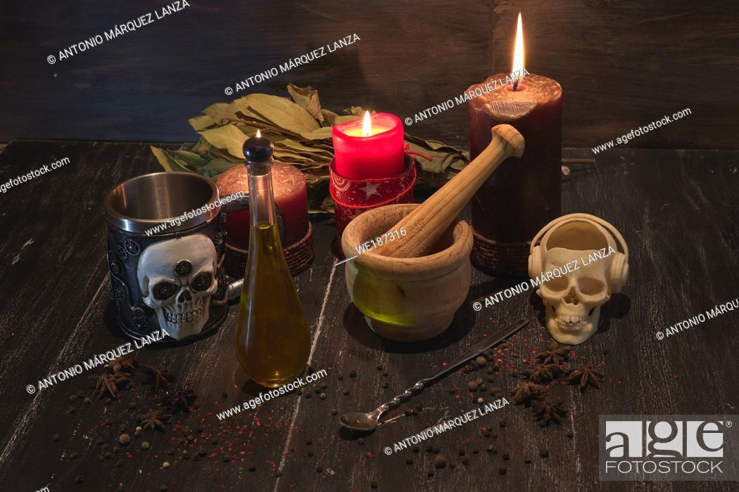 Stock Photo: potion of natural herbs for black magic with a skull incense burner, a mortar , candle and skull metal glass.