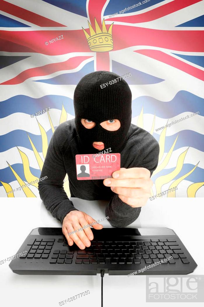 Photo de stock: Hacker with ID card in hand and Canadian province flag on background - British Columbia.