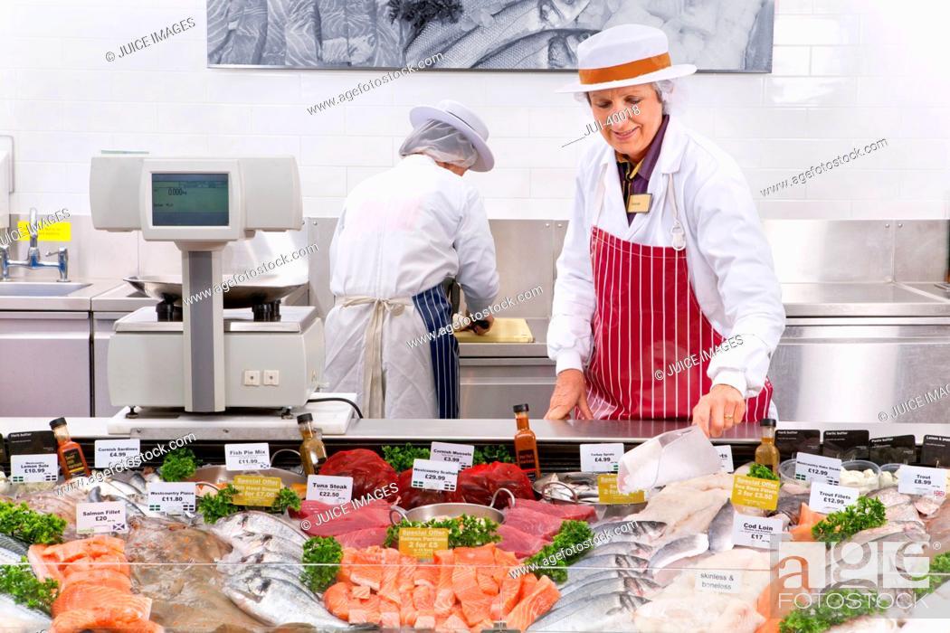 Photo de stock: Staff At Fresh Fish Counter In Supermarket.