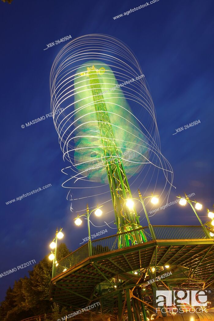 Stock Photo: The Star Flyer at night at Tivoli's gardens, Copenhagen, Denmark.