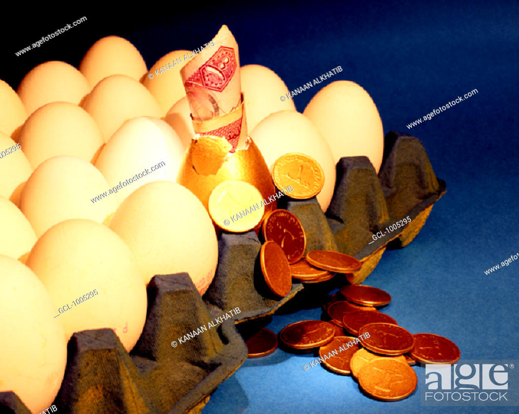 Stock Photo: Money sticking out of a golden egg.