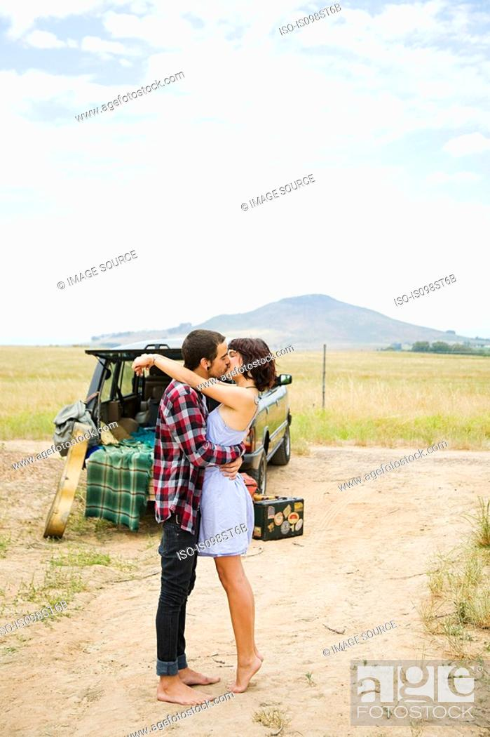 Stock Photo: Young couple kissing outdoors.