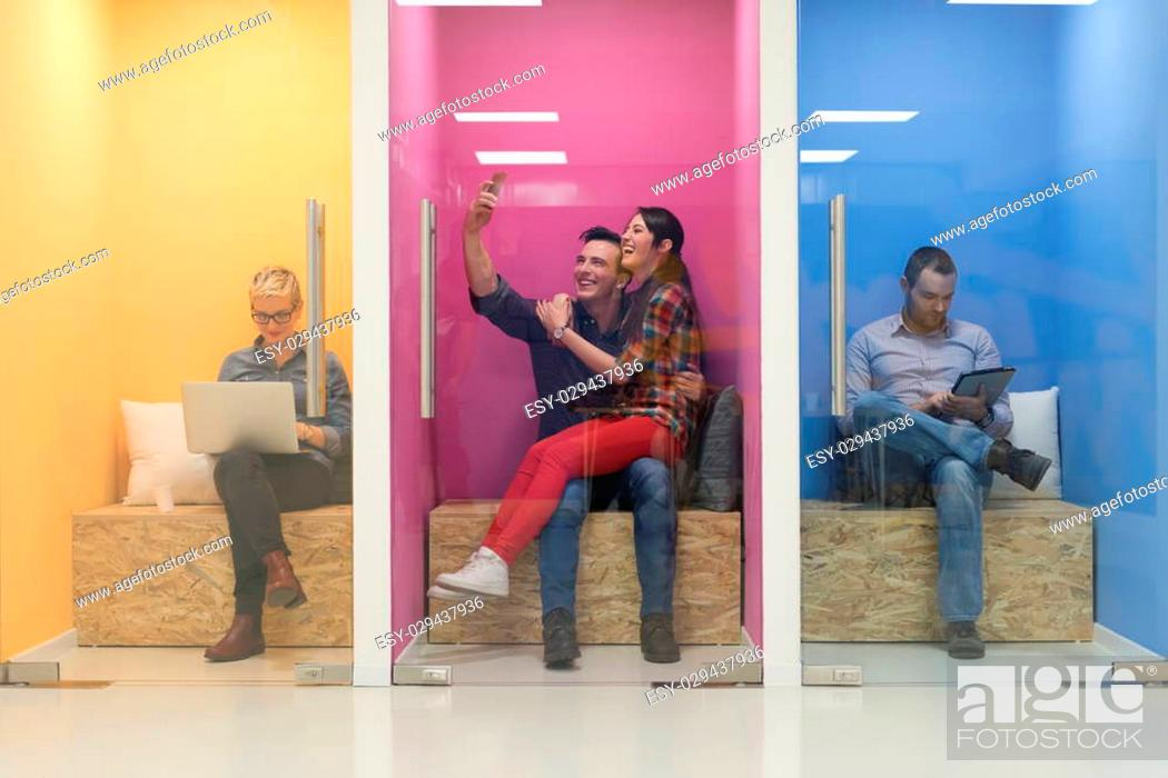 Stock Photo: group of young business people having fun, relaxing and working in creative room space at modern startup office.