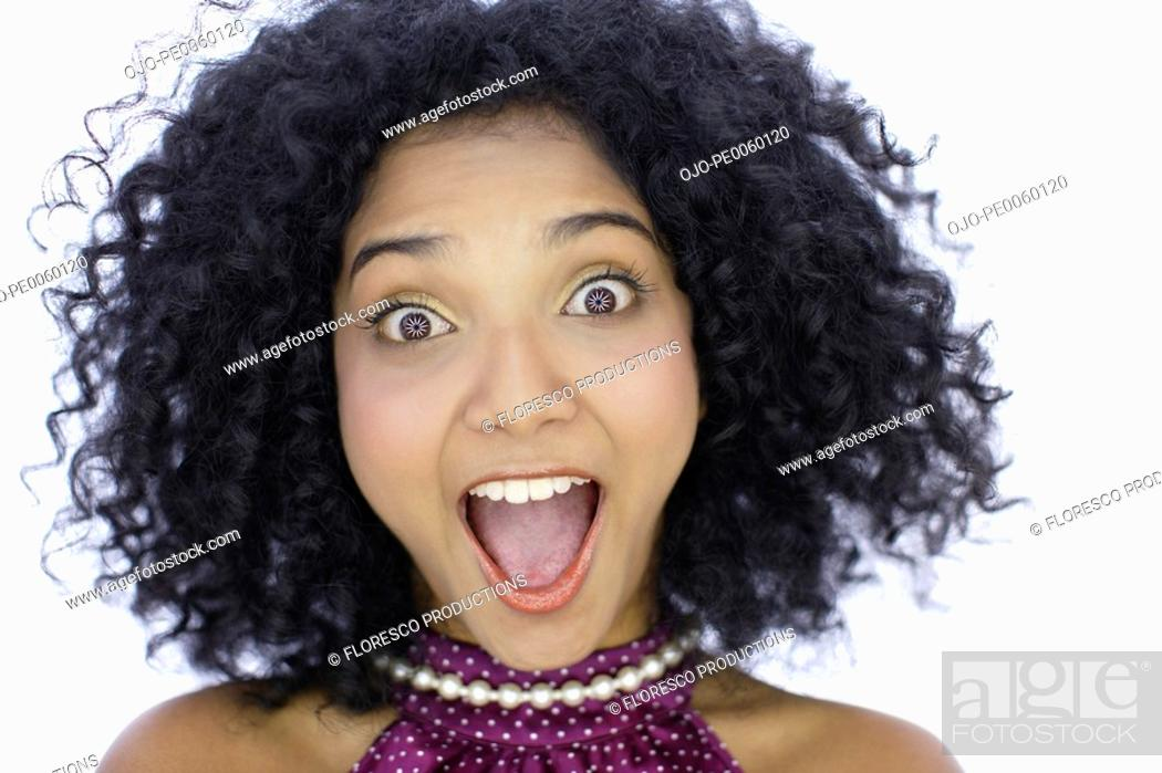 Stock Photo: Woman indoors with mouth open and purple eyes.