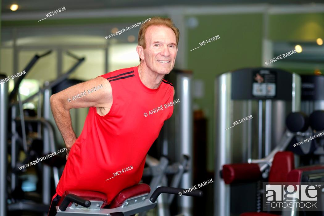 Stock Photo: Senior citizen man working out at a gym.