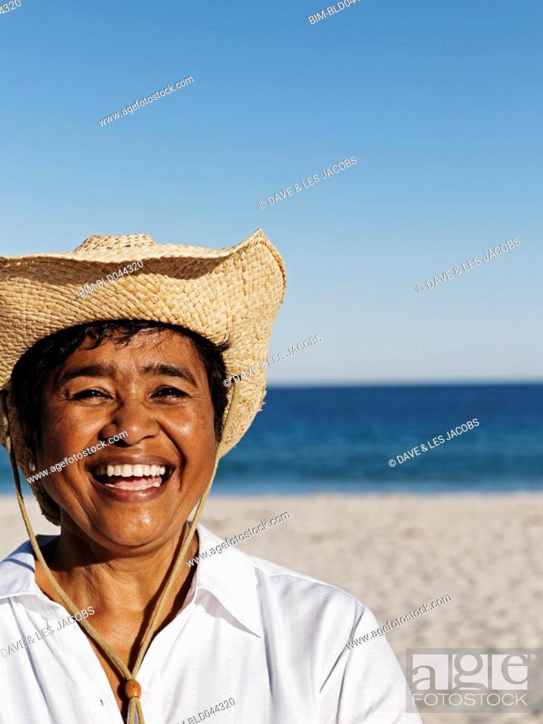 Stock Photo: Mixed Race woman wearing straw hat.
