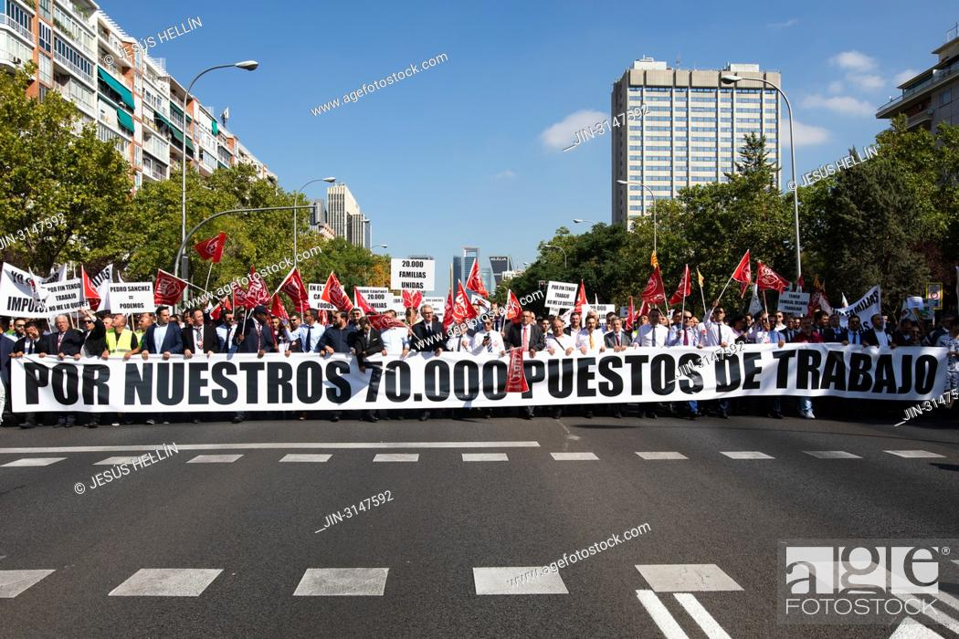 Stock Photo: Hundreds of drivers of VTC vehicles have demonstrated on Paseo de la Castellana to demand that the government avoid reducing licenses and the consequent loss of.