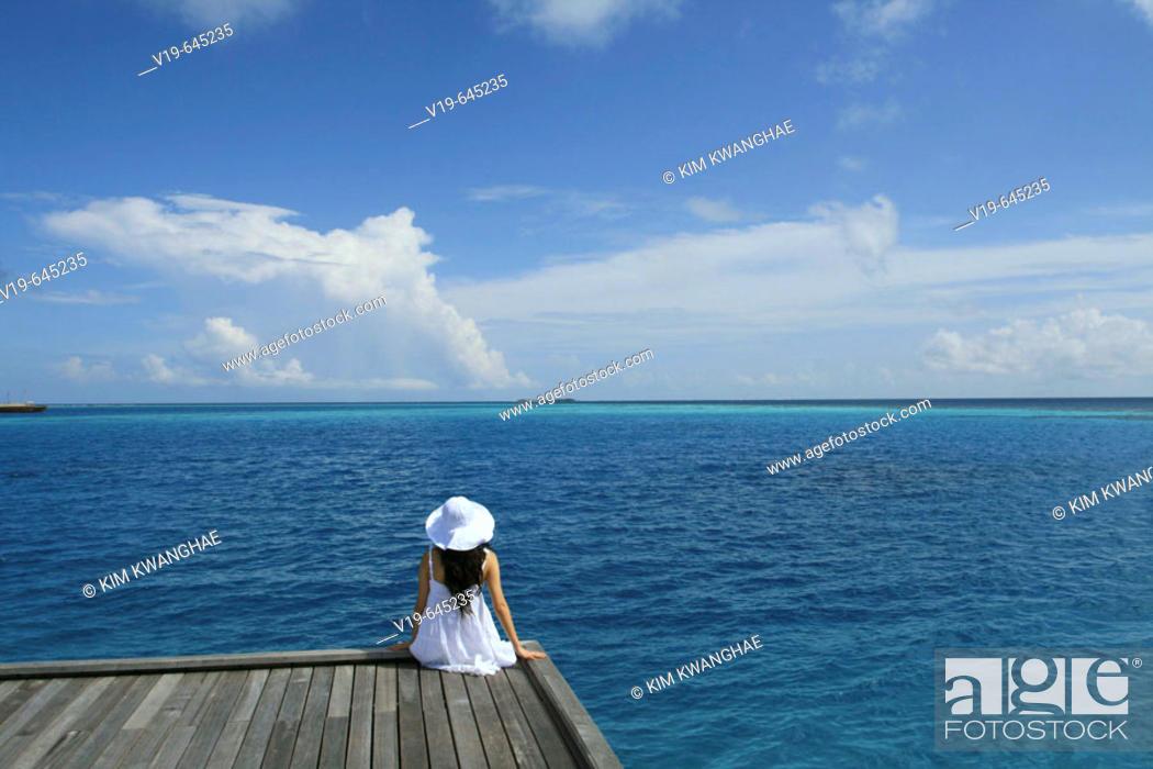 Stock Photo: Woman on swimmingpool, Maldives, Indian Ocean.