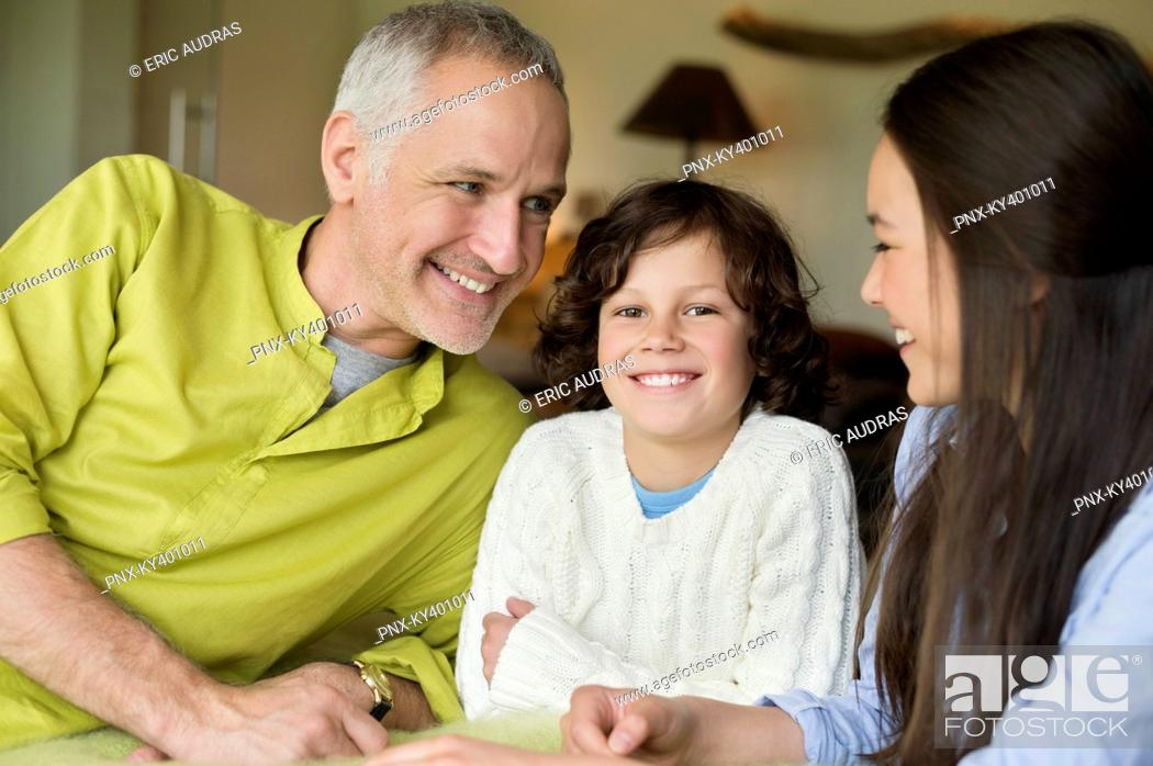 Stock Photo: Close-up of a man with his children smiling.