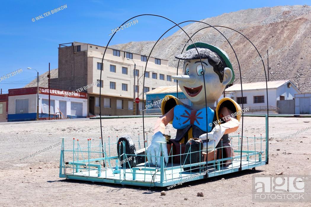 Stock Photo: Chile, Calama-area, Chuquicamata, former copper mining ghost town, Pinocchio statue on playground.