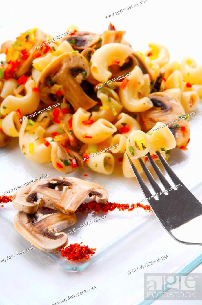 Stock Photo: Close-up of macaroni and mushrooms on a platter.