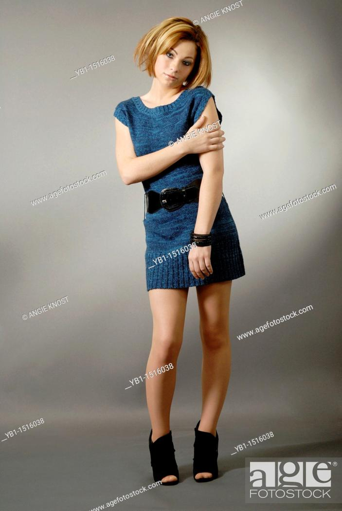 Stock Photo: Fashion image of a teenager girl wearing a sweater-dress, she has a trendy, short hairstyle with color highlights.