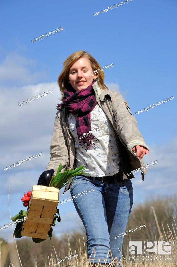 Stock Photo: Young woman with vegetable basket.