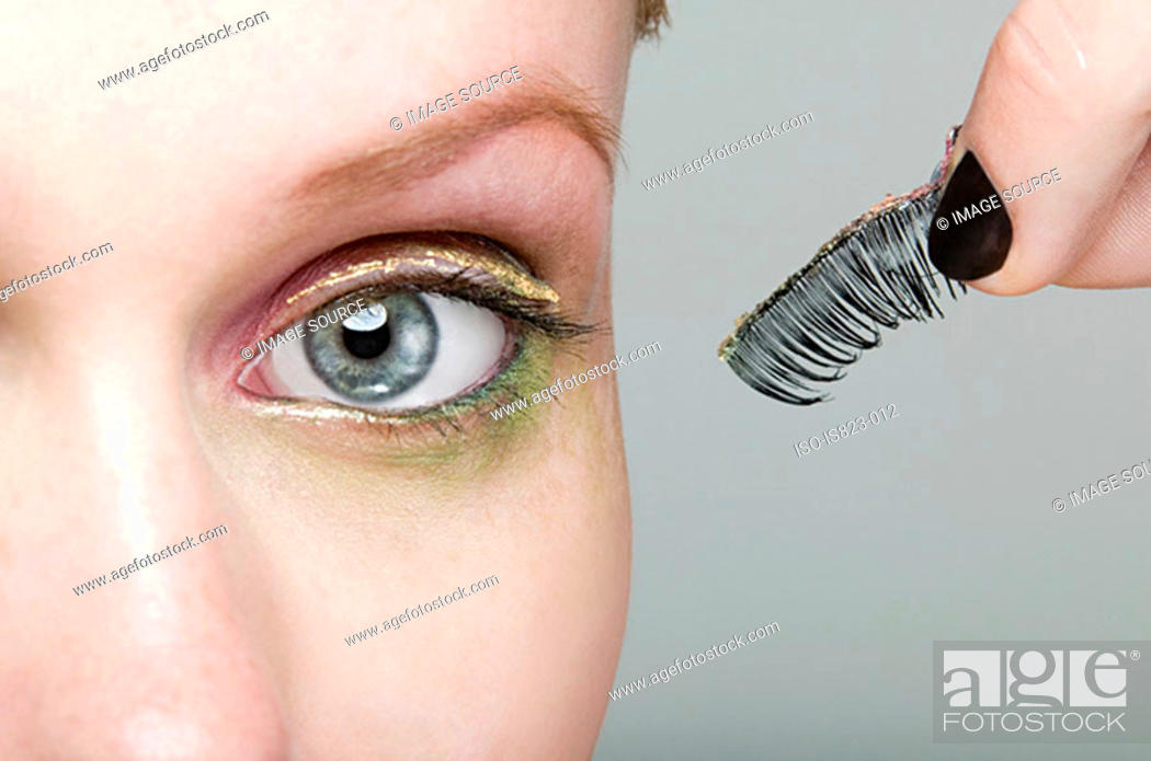 Stock Photo: Woman holding a false eyelash.