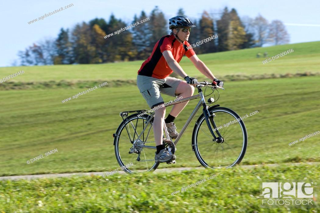 Stock Photo: Germany, Bavaria, Mature man riding bicycle.