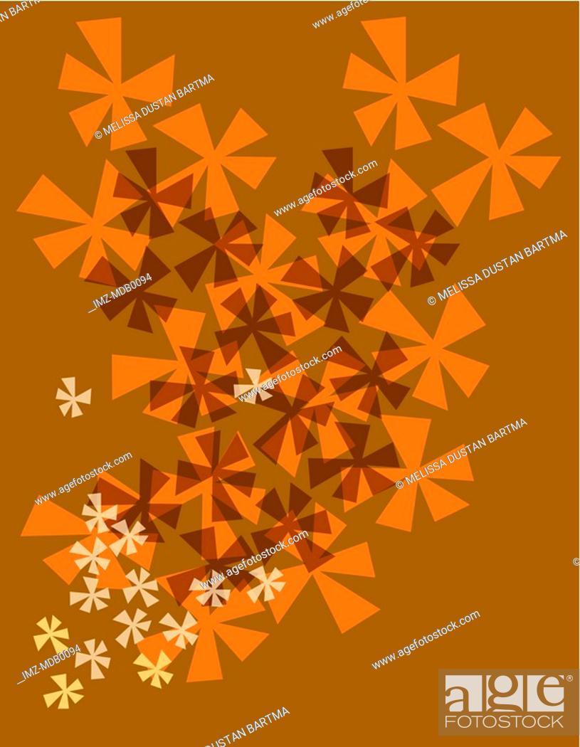 Stock Photo: Orange flower burst pattern on a brown background.
