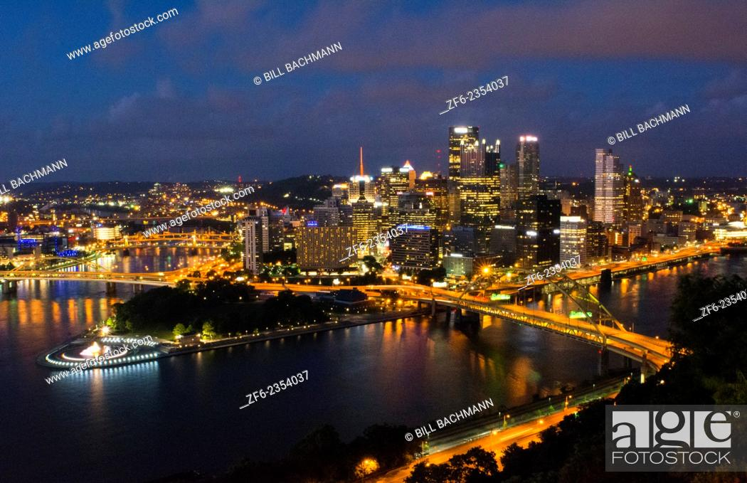 Stock Photo: Pittsburgh Pennsylvania skyline from Mt Washington of downtown city and rivers at Golden Triangle at night exposure of Three Rivers and fountain at point.