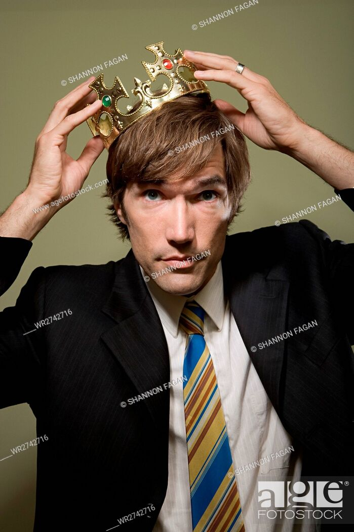 Stock Photo: Man trying on crown.