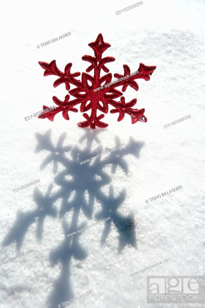 Stock Photo: Christmas red star in a snow day.