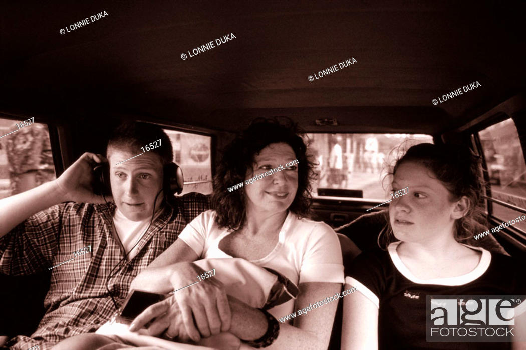 Stock Photo: Family riding in a taxi.