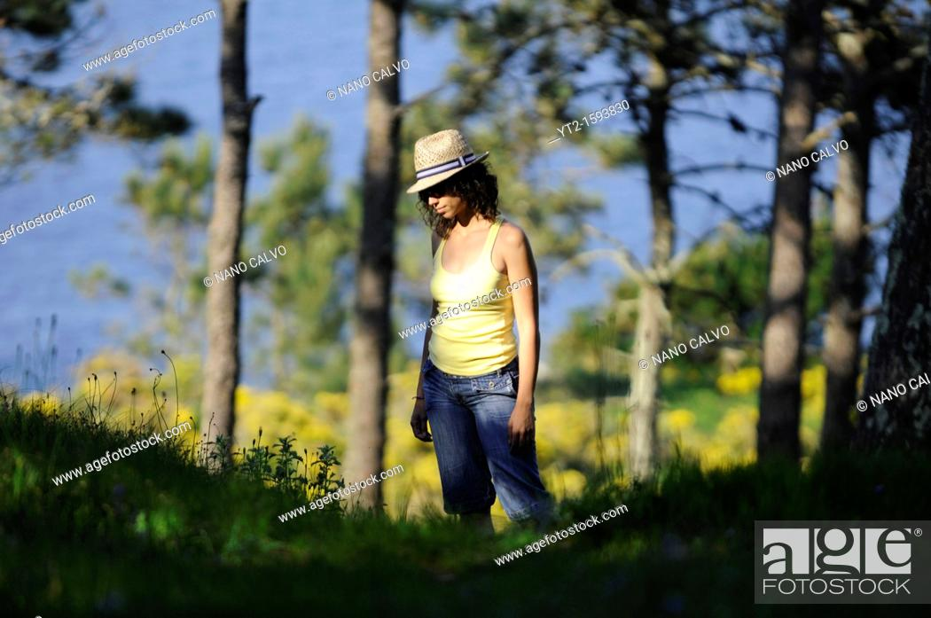 Stock Photo: Young attractive woman in Cies Islands, a paradisiac archipelago and Natural Reserve since 1908, off the coast of Pontevedra, in Galicia, Spain.
