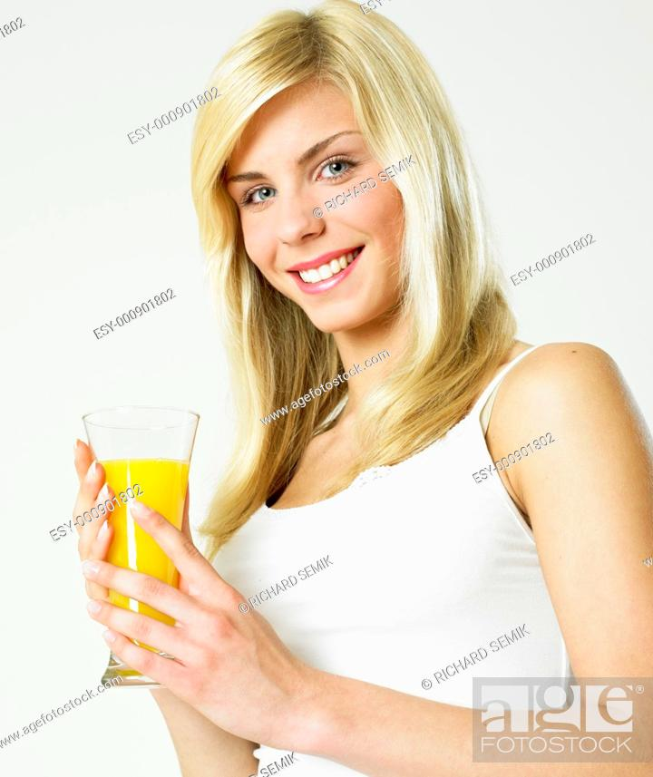 Stock Photo: woman with a glass of juice.