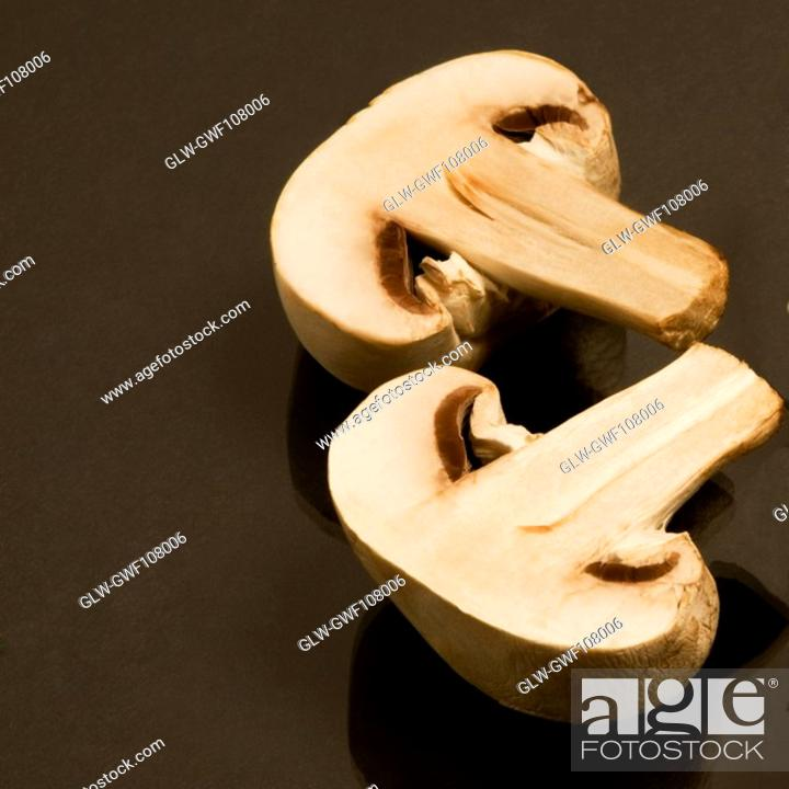 Stock Photo: Close-up of two halves of a mushroom.