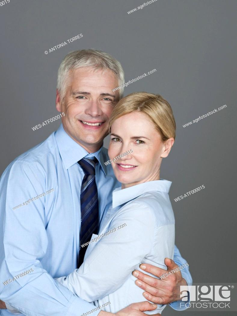 Stock Photo: Mature couple embracing each other, smiling, portrait.