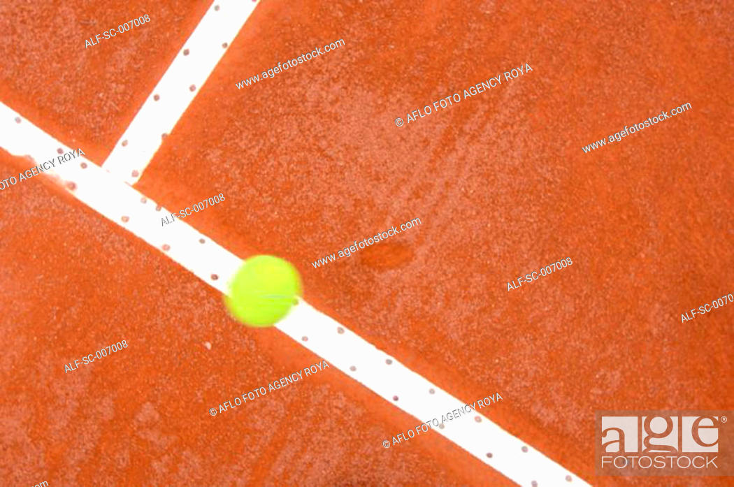 Stock Photo: Top View of Tennis Ball Hitting Court Line.
