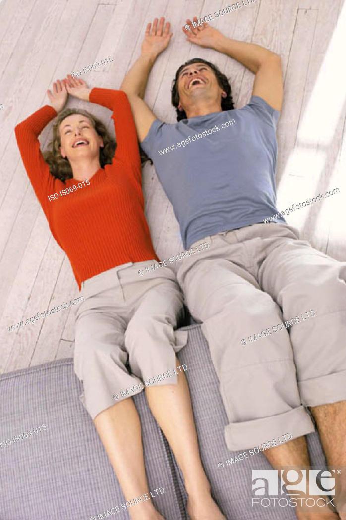Stock Photo: Couple lying on floor.