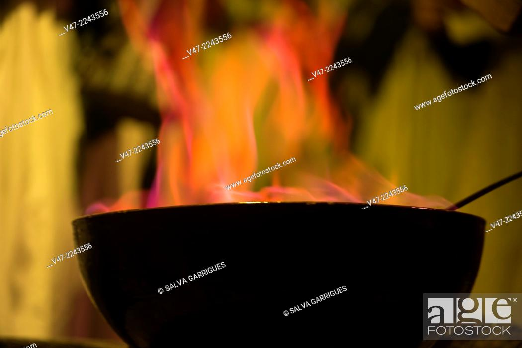 Stock Photo: A monk takes the spell of the typical queimada traditions and Galician cuisine, Galicia, Spain.