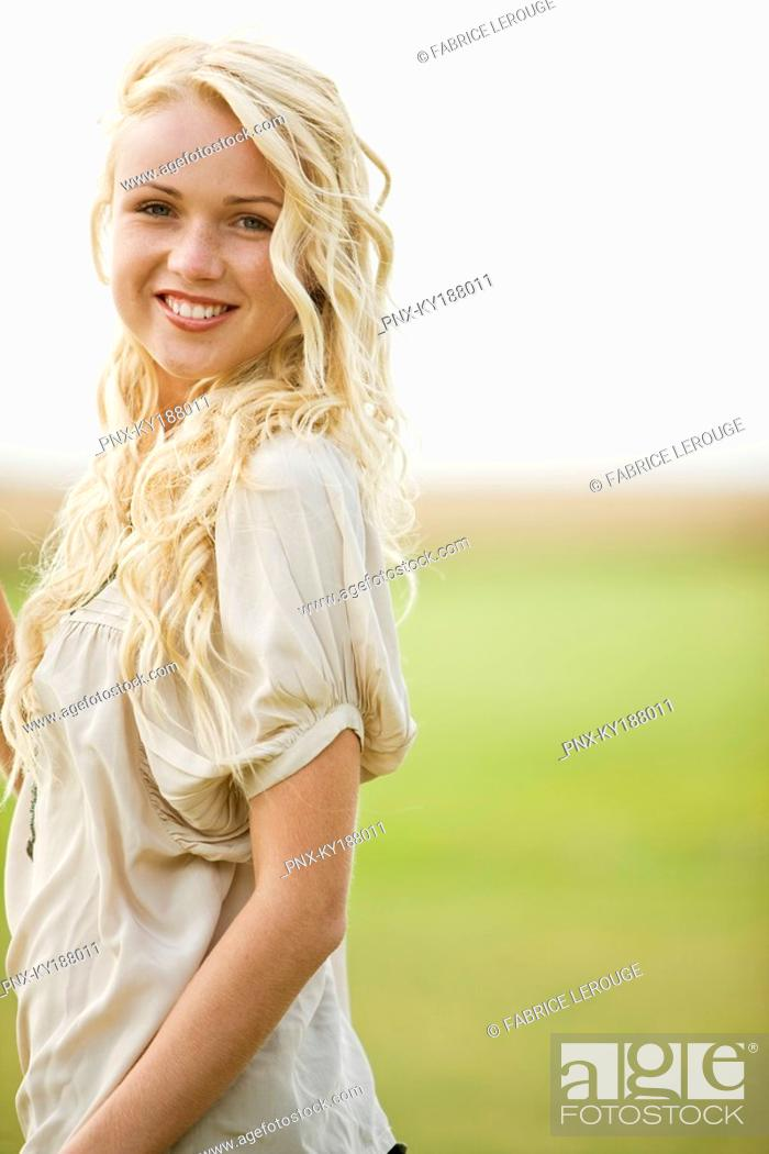 Stock Photo: Young woman, smiling.