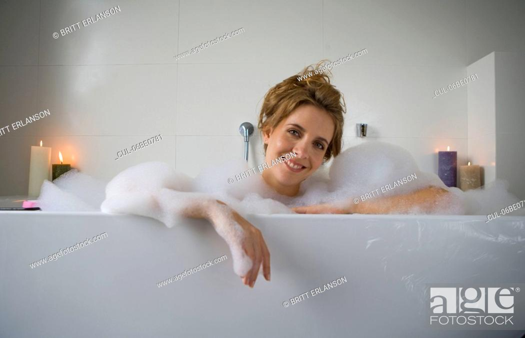 Stock Photo: Woman smiling in bathtub.