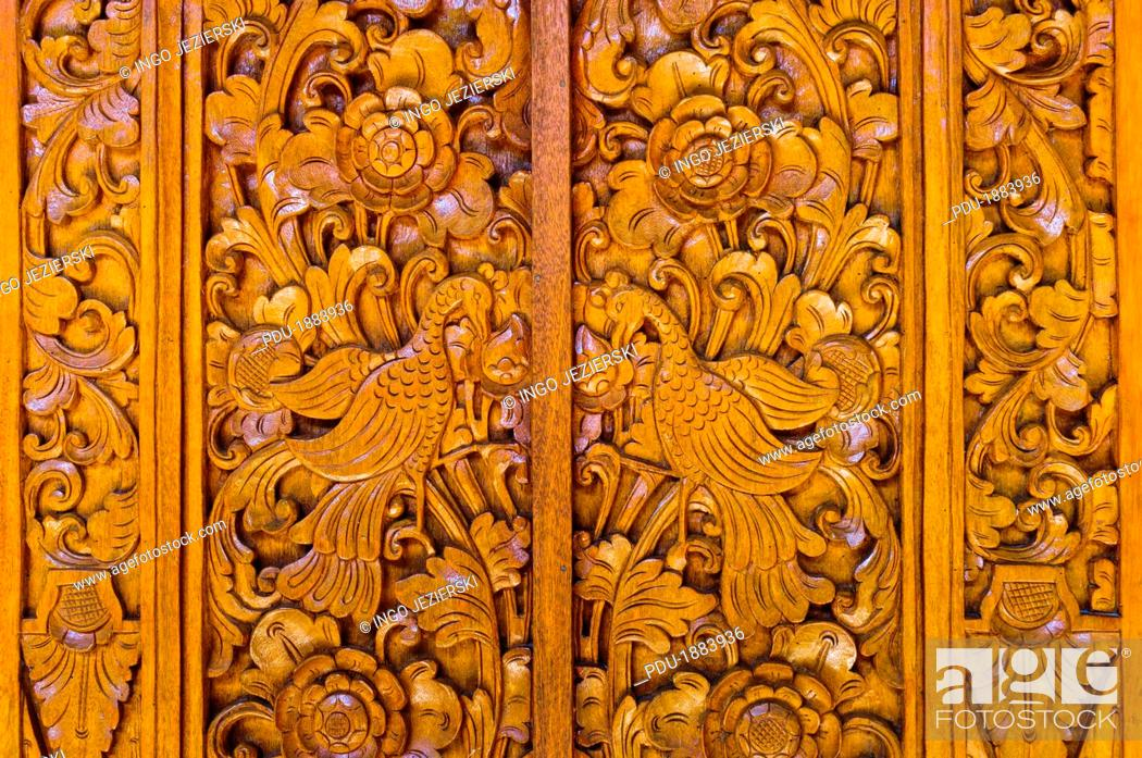 Stock Photo: Intricate wood carving on Bali door.