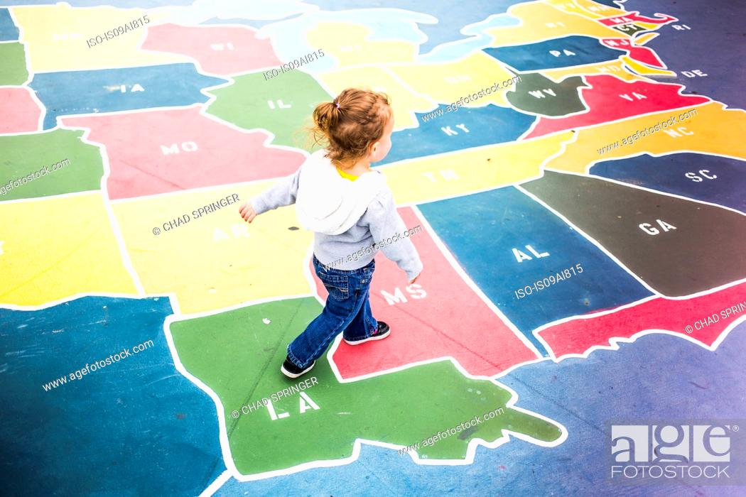 Toddler walking over map of USA in playground, Stock Photo, Picture ...